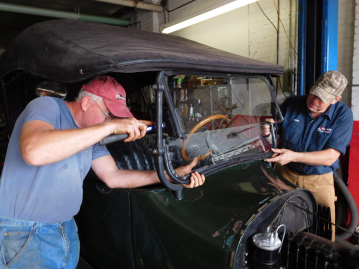 Bob Hansen (near camera) and Dave Sarna repair the Oakland windshield.