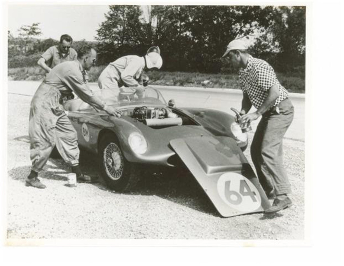 September 1959, Road America 500 - The Echidna shown during a pit stop on its way to a B/Modified class win. Ed Grierson climbs in replacing John Staver (left front) while Bill Larson refuels, (rear) and Don Skogmo adds oil (front).