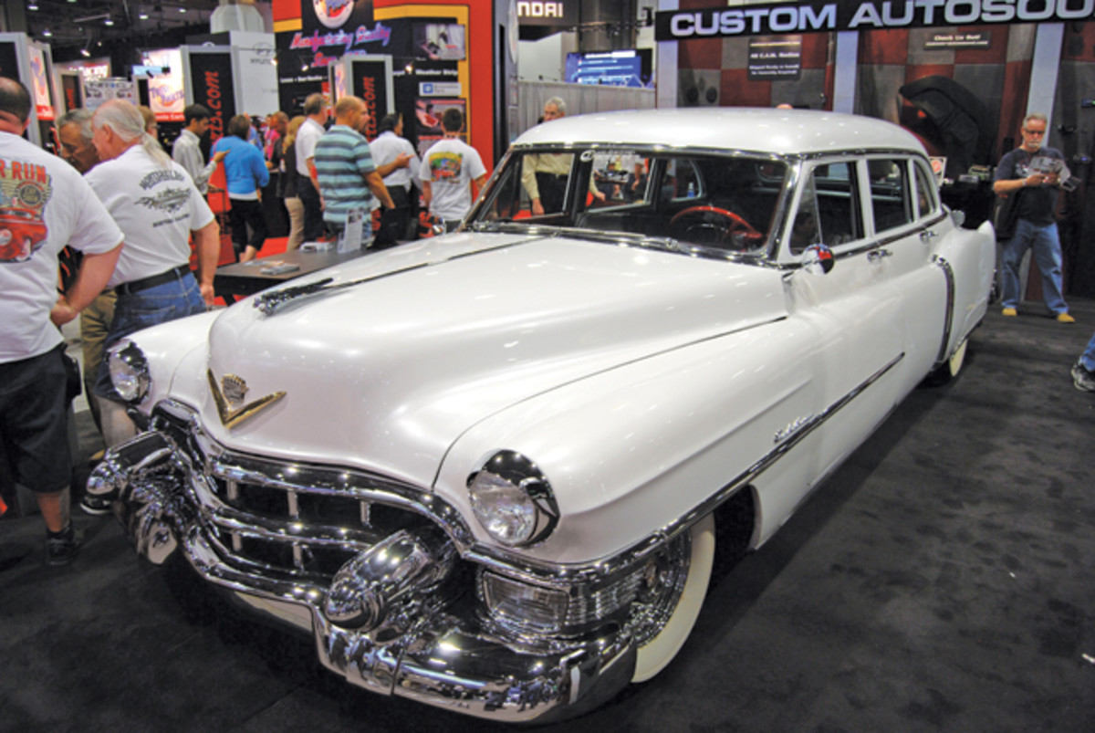 A giant white Cadillac was a featured car in the Custom Autosound booth.