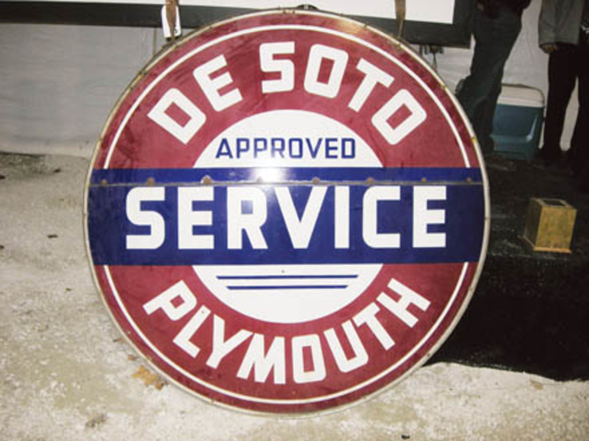 Equipped with mounting brackets, this circular, two-sided, porcelain De Soto/Plymouth Approved Service sign sold for $3,000.