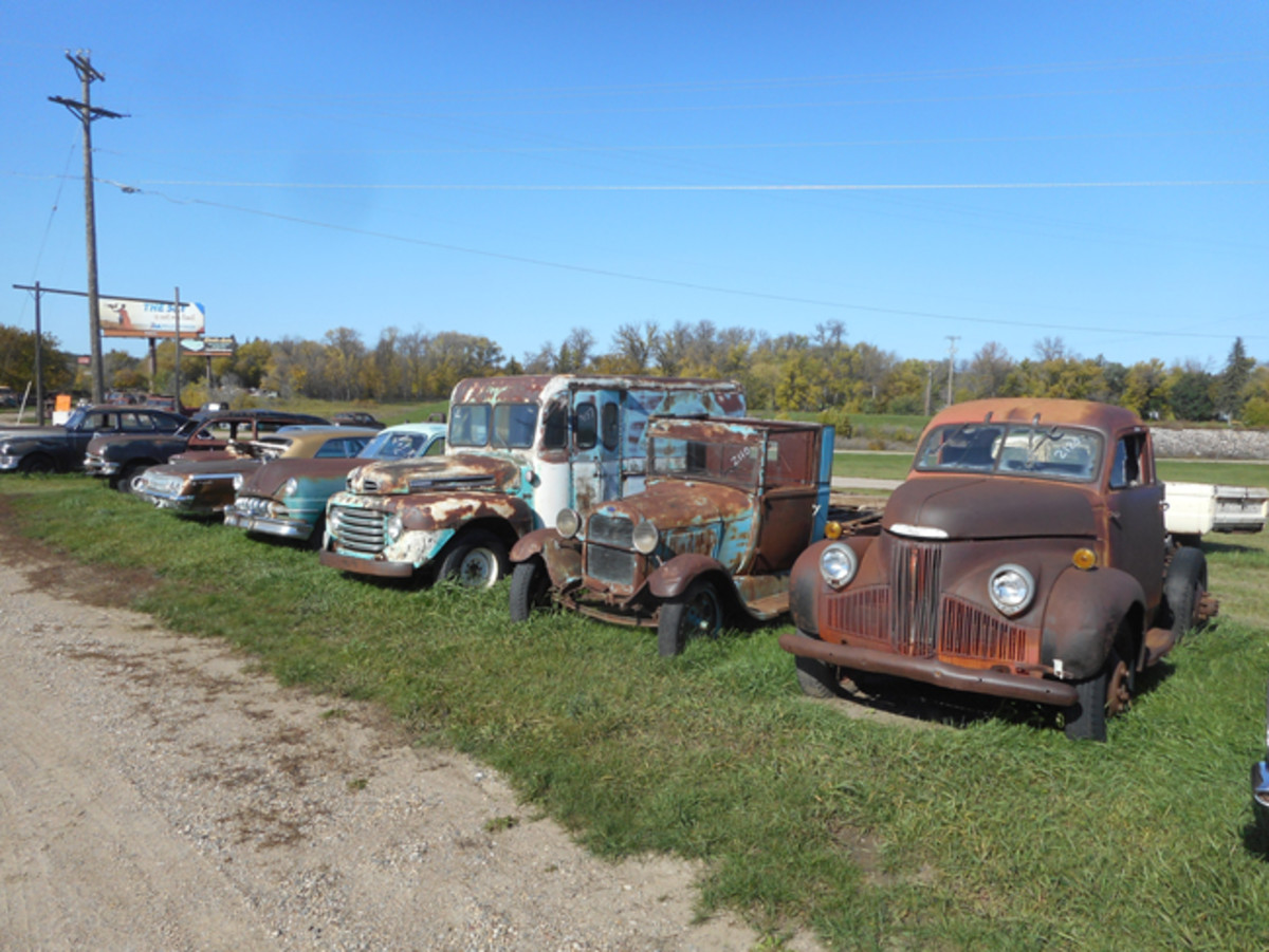 A row showing the variety at Dick's Auto. From a 1962 Impala Sport Coupe to a Ford Model A Ford pickup, with orphans from Studebaker and De Soto thrown in, there's a bit of everything.