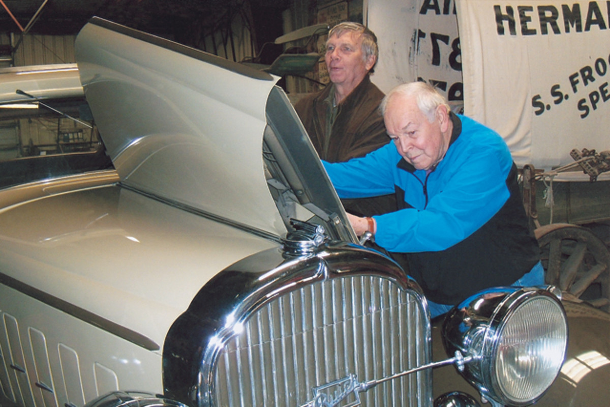 Len Anderson (left) spent a day going over the car with Harold Mohagen (right) the day Mohagen sold the car to Anderson, who knew the car well; it was the first car he drove.