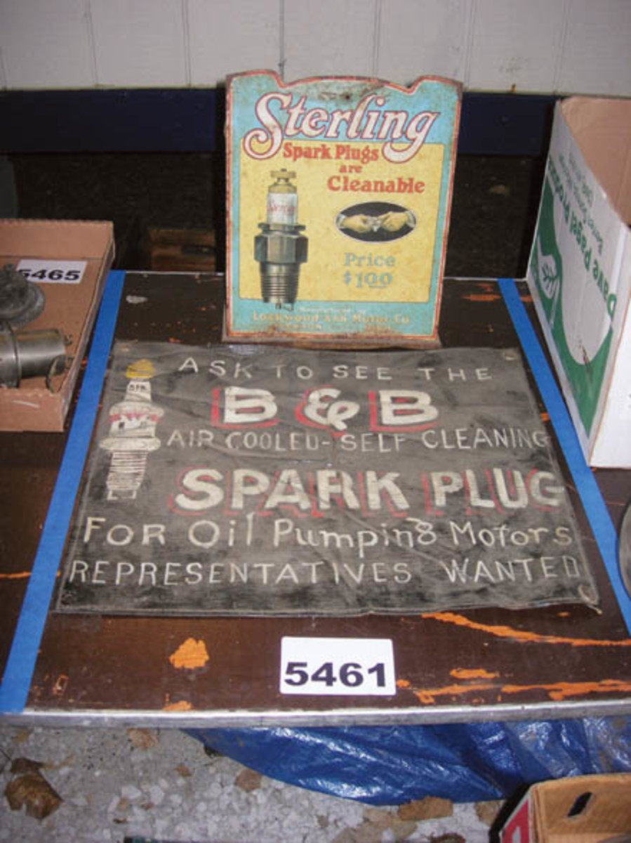 Items of a similar theme were often grouped together in one lot, such as this Sterling spark plug tin sign and B&B spark plug cloth banner. The pair sold for $700.