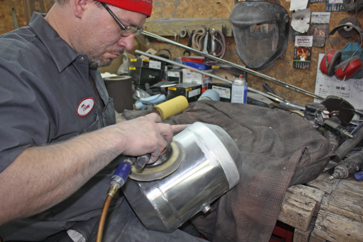 Not all of the parts CPS works on will get a new chrome finish. Stainless pieces, like this gas tank being worked on by Tim Meetz, get straightened and repaired, then buffed polished.