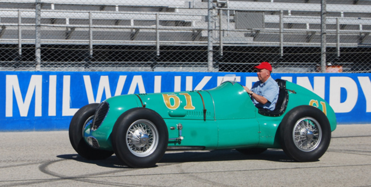 """William Miller of Frankfort, Ind., takes to the track in his vintage Indy racer during the Harry A. Miller Club's """"Millers at Milwaukee"""" meet on July 12-13 in Milwaukee, Wis."""