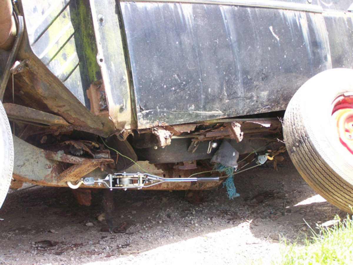 The '57 stored at the wrecking yard suffered from decades of rust, resulting in this broken chassis.