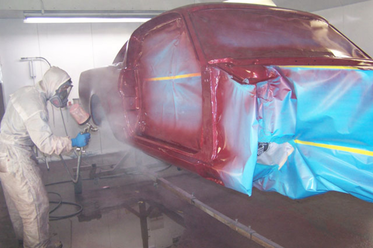 Spraying clear generates a particularly large amount of fog in the spray booth and requires close attention while spraying to ensure full coverage. While spraying each coat, the painter started at the farthest point from the exhaust and worked toward it so the paint materials were not pulled over freshly painted areas.