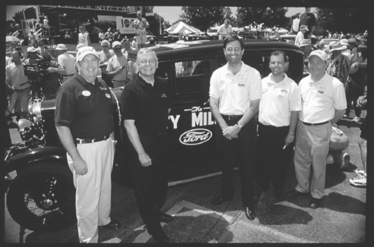 The Old Cars Weekly staff with the 20 Millionth Model A Fordor during the 2002 Iola Old Car Show.