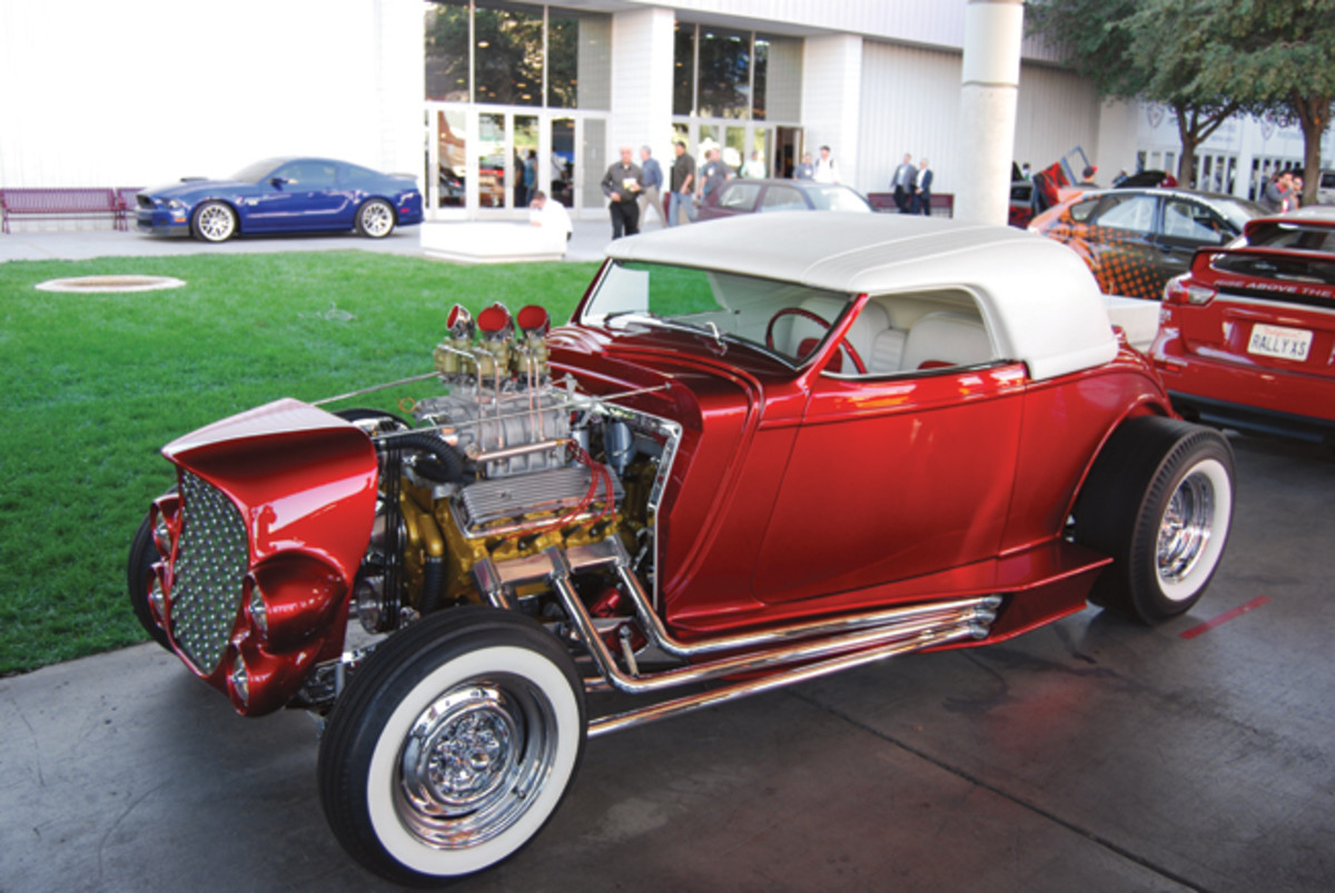 One of the first hot rods we spotted at SEMA was one of our favorites, too. The Carson-topped, fender-less, drawer-pull-grille roadster was perfection.
