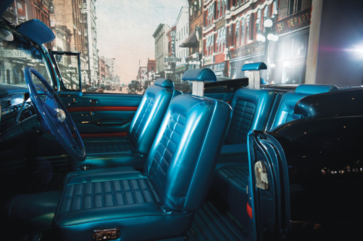 All four headrests of the custom blue bucket seats were power periscoping units.