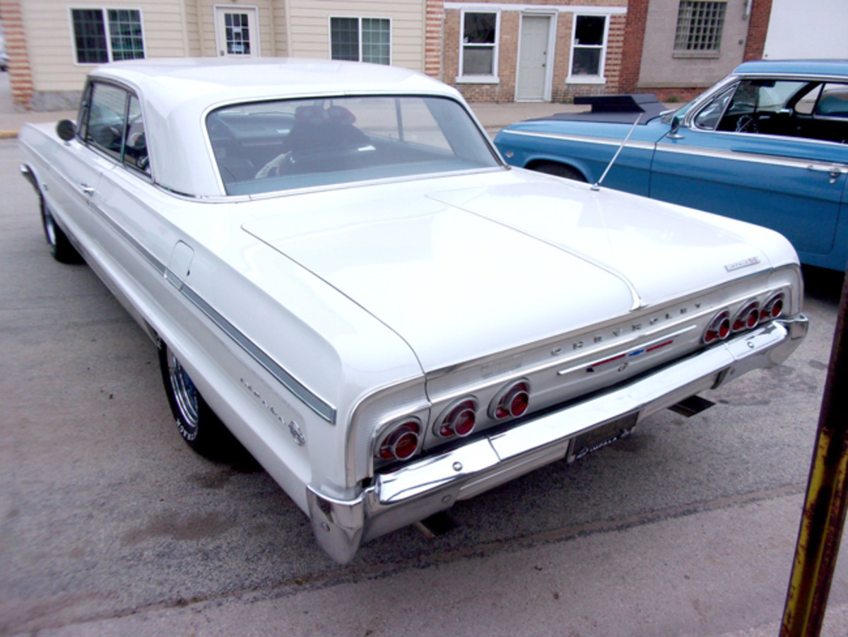 This car's original tail lamps — Impala and Impala SS models had two on each side plus a backup lamp — were replaced with reproductions that have the Chevy bow tie emblem on them, outlined in white.