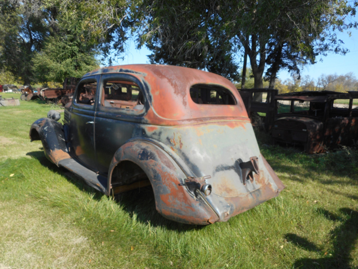 Other than wheels, this 1935 Ford Tudor looks largely intact.