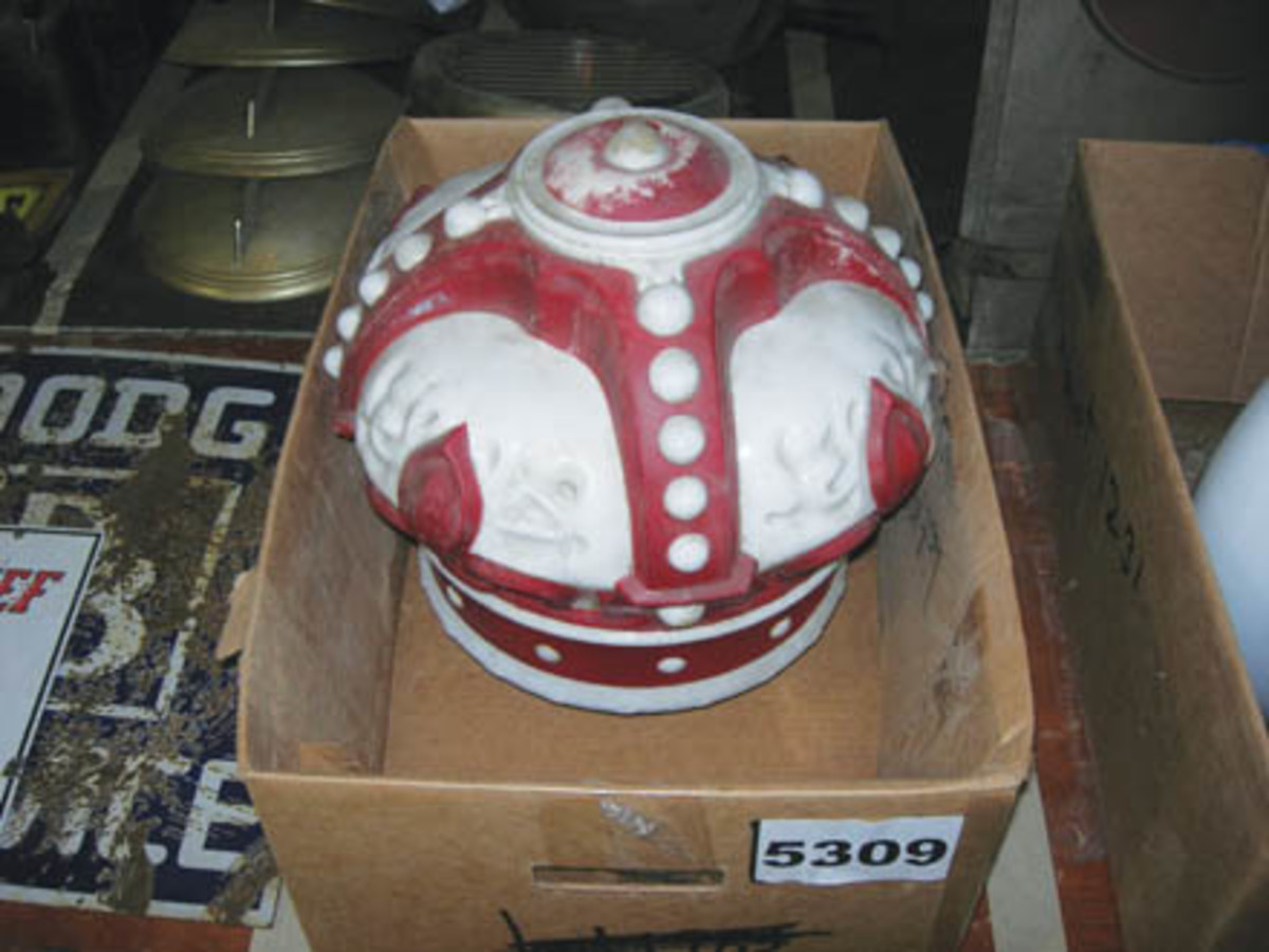 This one-piece painted milk-glass White Crown gas globe sold for $550.