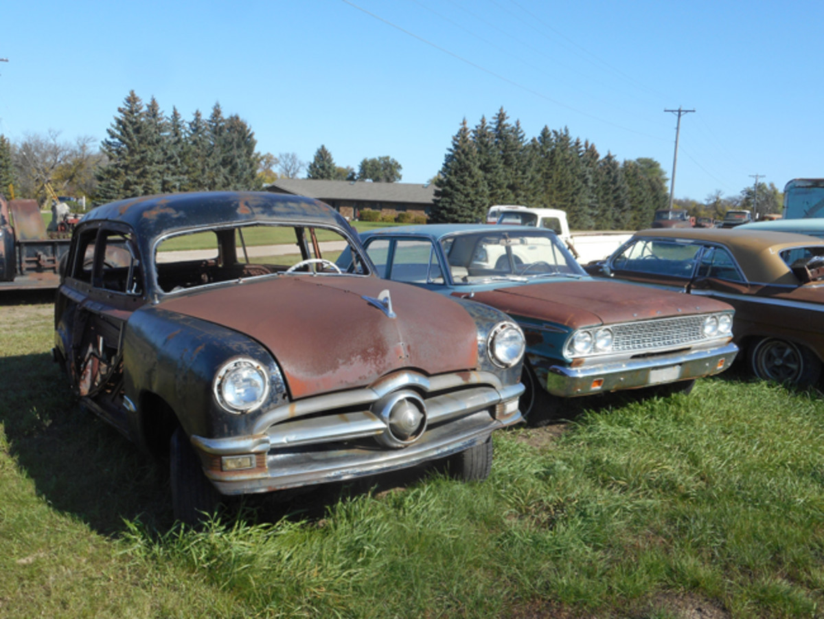 Woodie projects are getting scarce, but this 1950 Ford station wagon has potential. The adjacent 1963 Ford Fairlane two-door sedan is also worthy of a closer look.