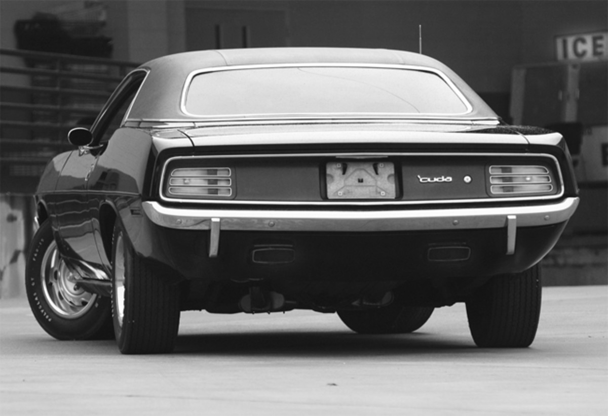 From the back (the view most posers had), the 1970 'Cuda featured a wide rear panel, tail lamps with three horizontal openings and the two roaring exhaust exits that came through the lower valance.