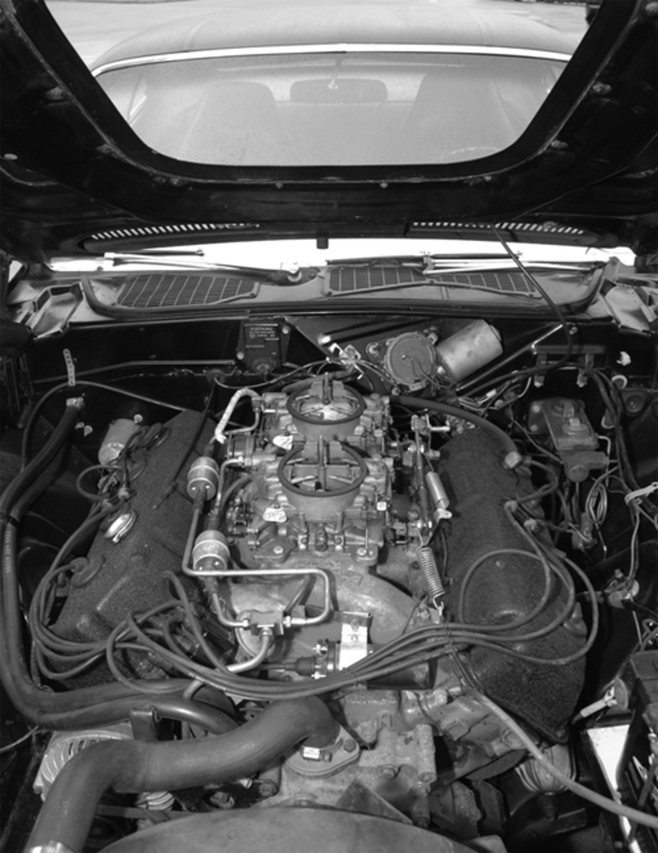 You are looking at a Hemi engine which has never been heavily modified; the broker who found the car added a factory set of carburetors to replace the originals, which had been lost during its storage. Other than oil and valve cover gaskets, it is stock – plugs, wires, etc.
