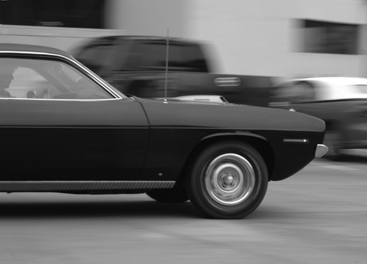 """In the parking lot, Bruce gave the big engine a chance to breath some fresh air. On the dragstrip, 1970s Hemi 'Cudas, in proper tune, could run down into the 13-second bracket. Since the car was optioned with a body side molding, the normal """"hockey stripe"""" decal was never applied."""