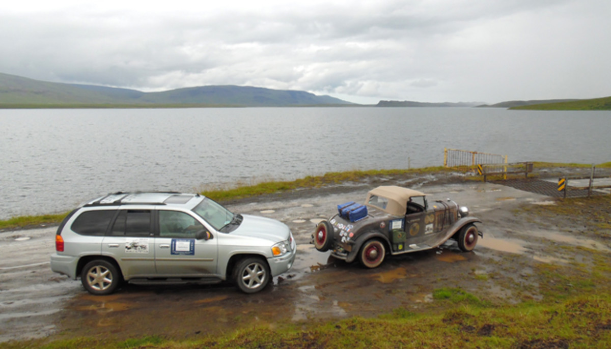 John Quam's 1928 Plymouth roadster and Leo Jansens' GMC Envoy in Iceland.