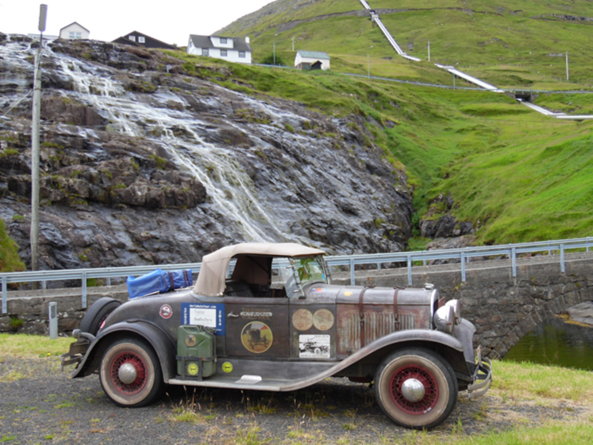 John Quam's 1928 Plymouth roadster at a remote fjord on the Faroe Islands.