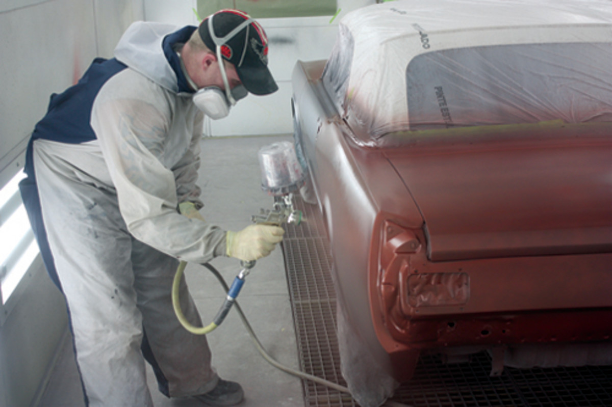 Shawn Schrock lays down the first layer of paint on a 1966 Mustang at Kasper Automotive in Waupaca, Wis.
