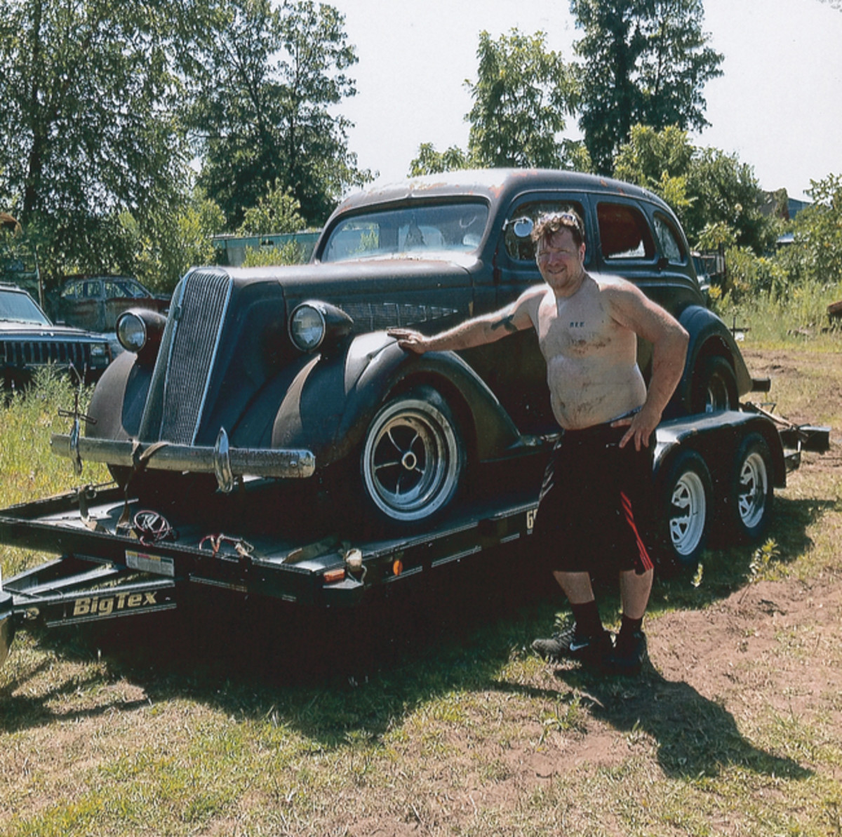 Raymon Alt of Ironton, Wis., poses with the 1936 Nash 400 Deluxe sedan he purchased on Golden Sands Salvage's final day of business under current ownership. The car was previously updated with a modern Chevy drivetrain. Alt intends to restore the car to a period hot rod.