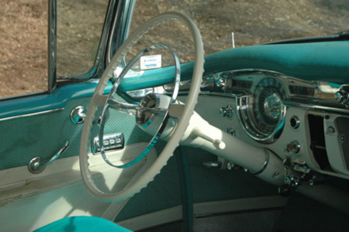The round speedometer mimicks the round steering wheel and horn button, which repeats the globe theme on the hood and deck.