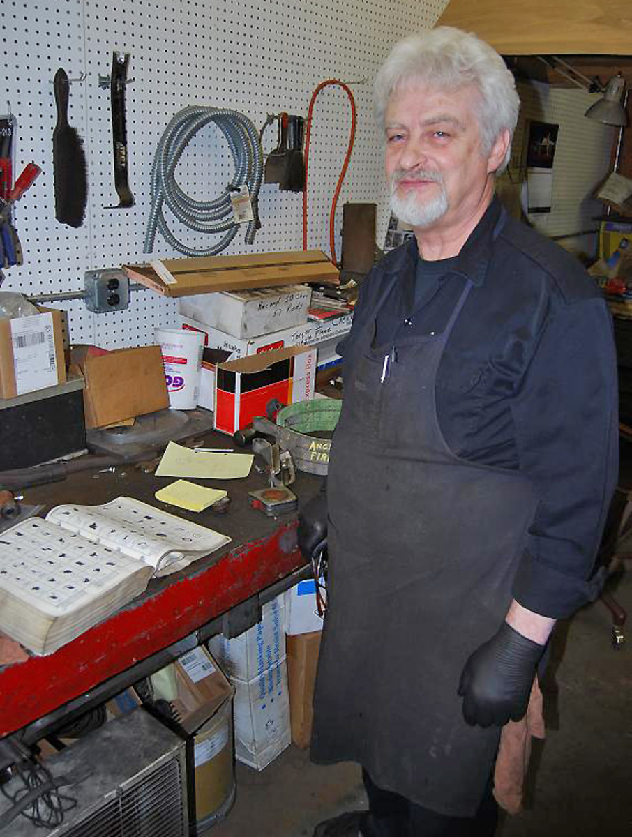 A good assortment of old exhaust parts books helps Bob find the proper clamps and hangers and other parts.