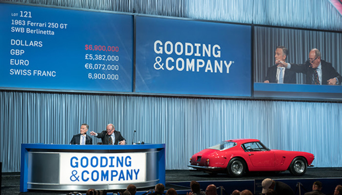L-R: President David Gooding and Auctioneer Charlie Ross sell the 1963 Ferrari 250 GT SWB Berlinetta for $7,595,000. Photo copyright and courtesy of Gooding & Company. Image by Jensen Sutta.