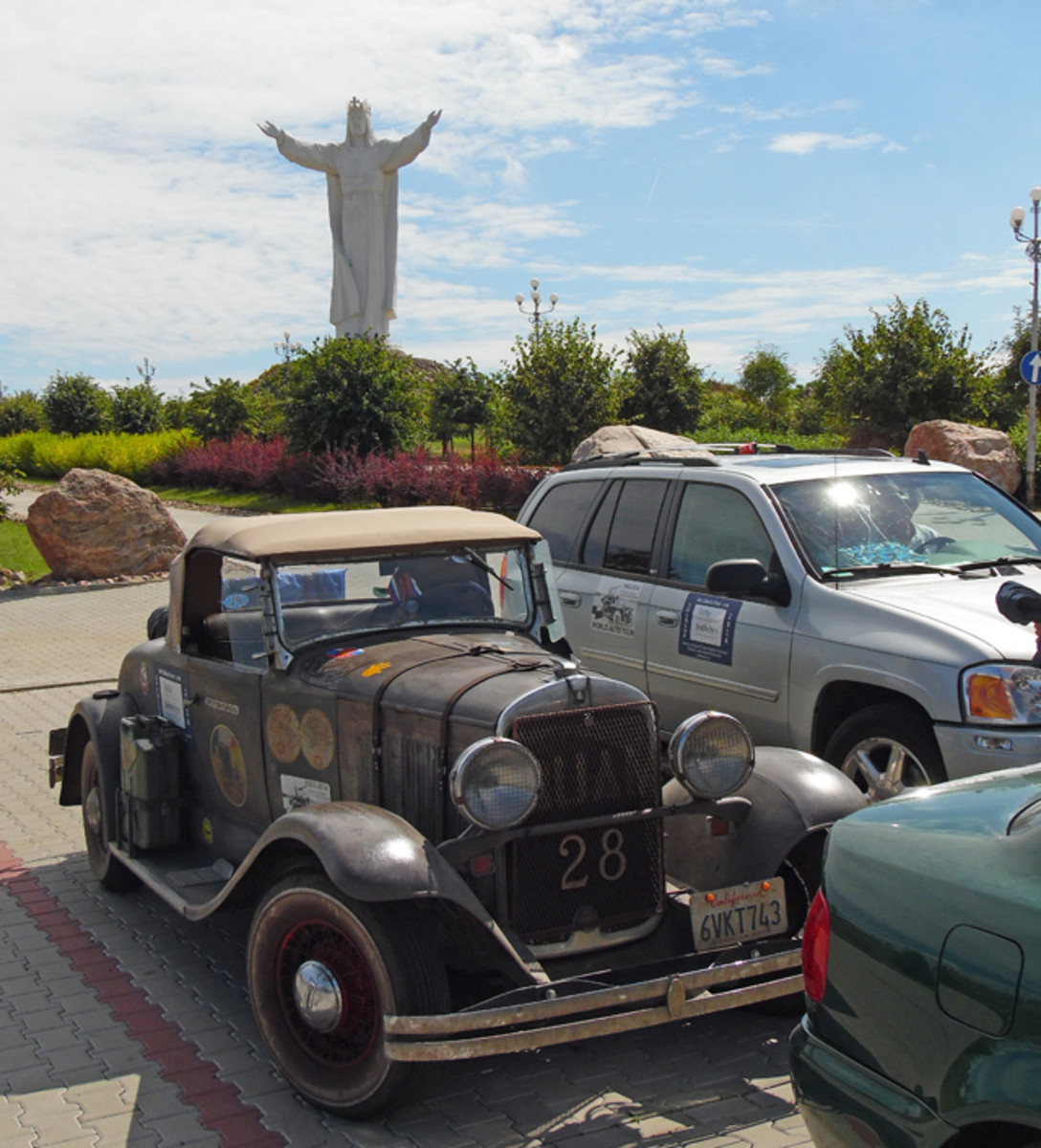 The Plymouth and Leo Jansens' late-model GMC Envoy parked near the world's largest Jesus statute located in Poland.
