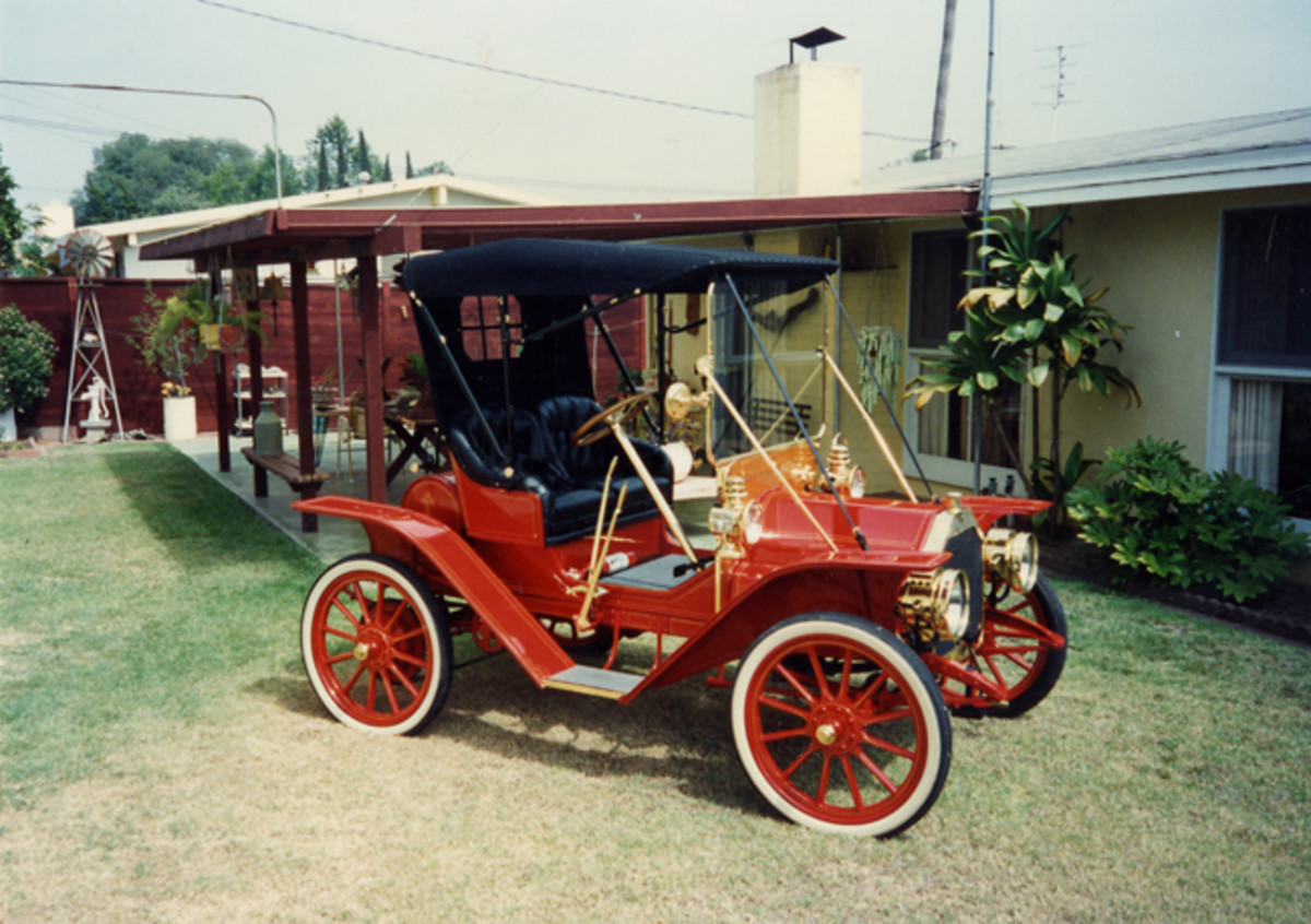 """Dr. Phil Ruben has a collection that includes a 1910 Buick """"Buggyabout"""" and a 1904 curved-dash Olds. The Buick became part of his collection about a year ago, but the Olds has been in Ruben's garage a long time — he says it took him more than 20 years to restore."""