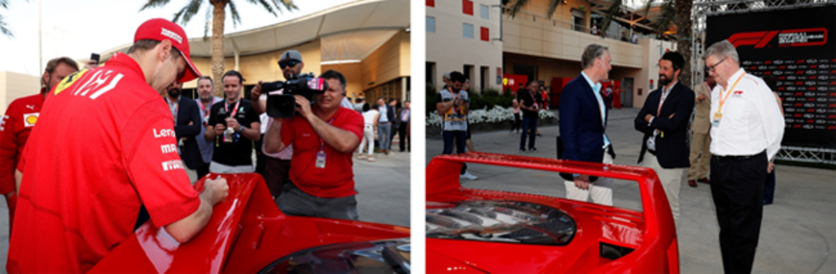 Left: Formula 1 driver Sebastian Vettel signs the rear wing of a Ferrari F40 at the Bahrain GP press conference, ceremoniously united Formula 1 and RM Sotheby's in their global collaboration.Right :Sean Bratches, Shelby Myers, and Ross Brawn (Managing Director of Motorsports, Formula 1®) chat during the collaboration announcement at the Gulf Air Bahrain Grand Prix 2019 - © Motorsport Images