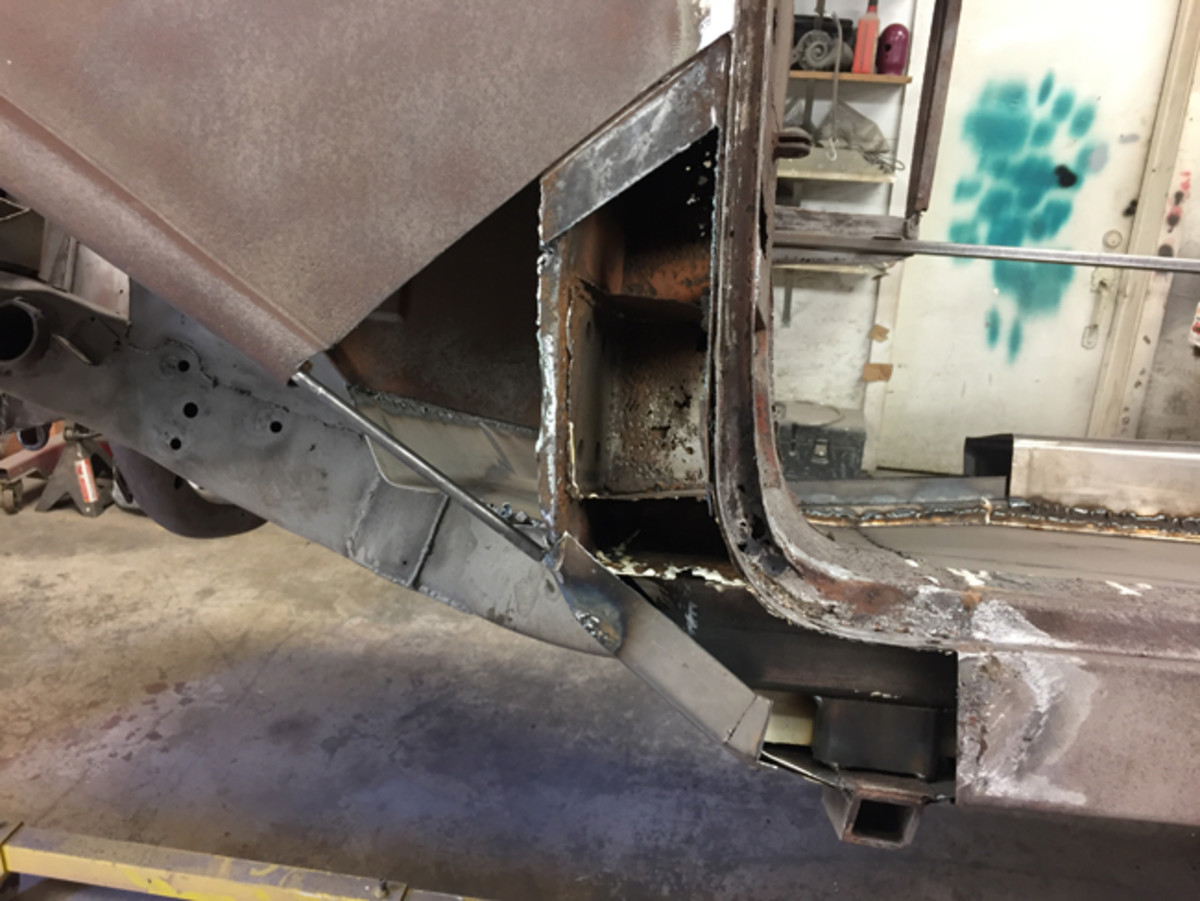 The lower A pillar was thoroughly rusted and the old metal had to be cut out and replaced on this complicated area.