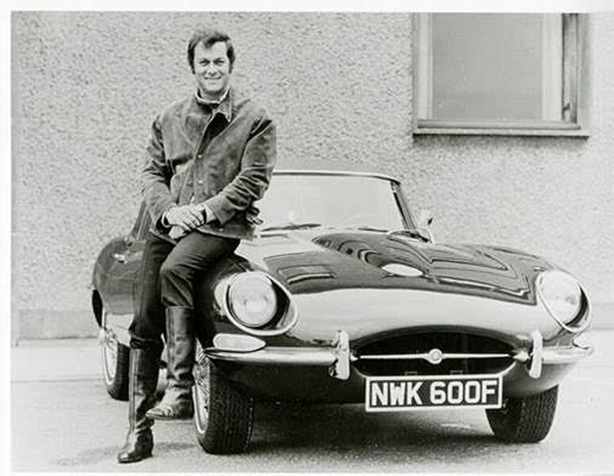 Actor Tony Curtis poses with his Jaguar E-Type