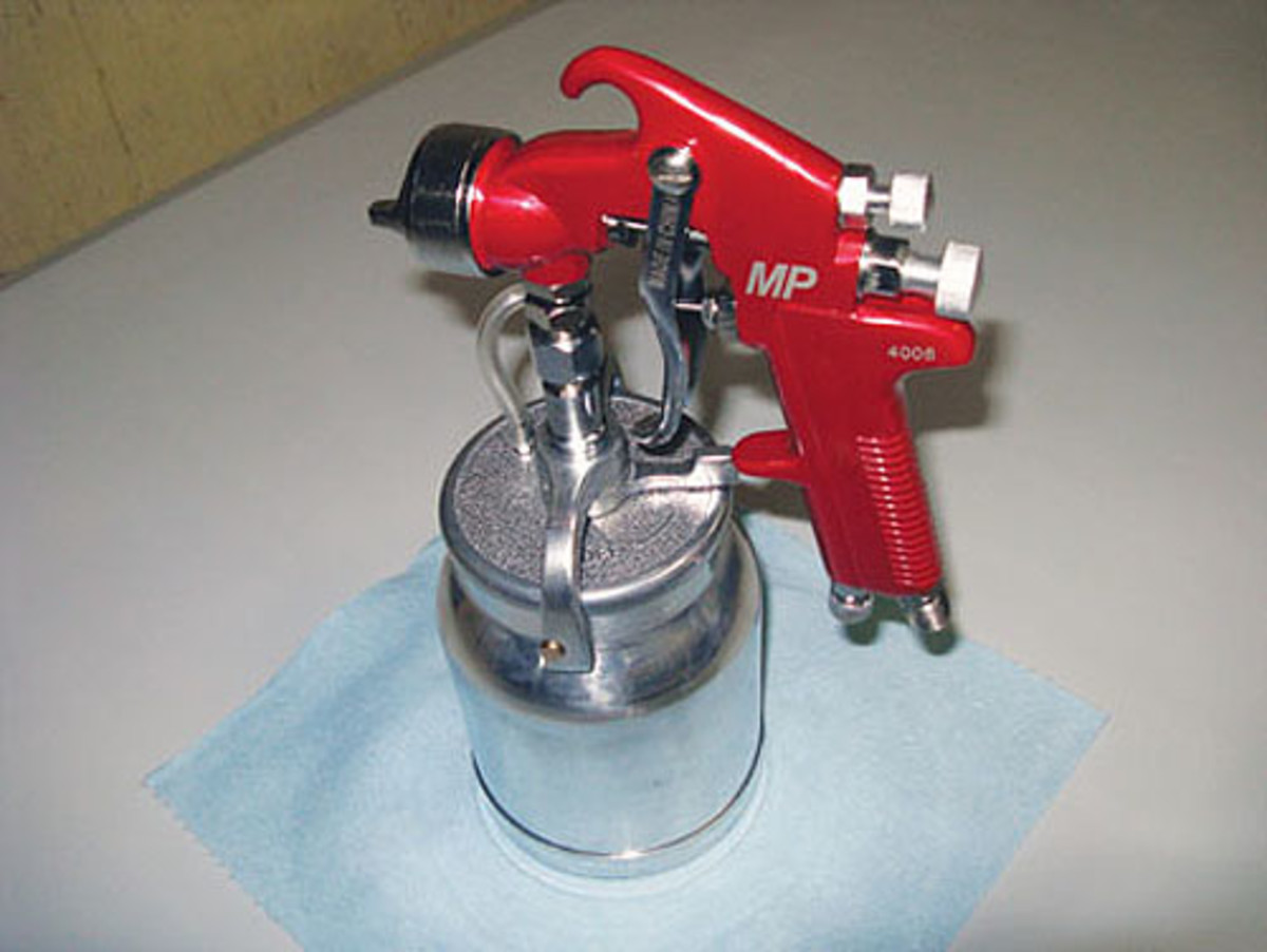 This red-handled Siphon fun spray gun by Astro is good for primer and has allthe traditional adjustments. Expect to get a good-quality gun such as this forless than $50.