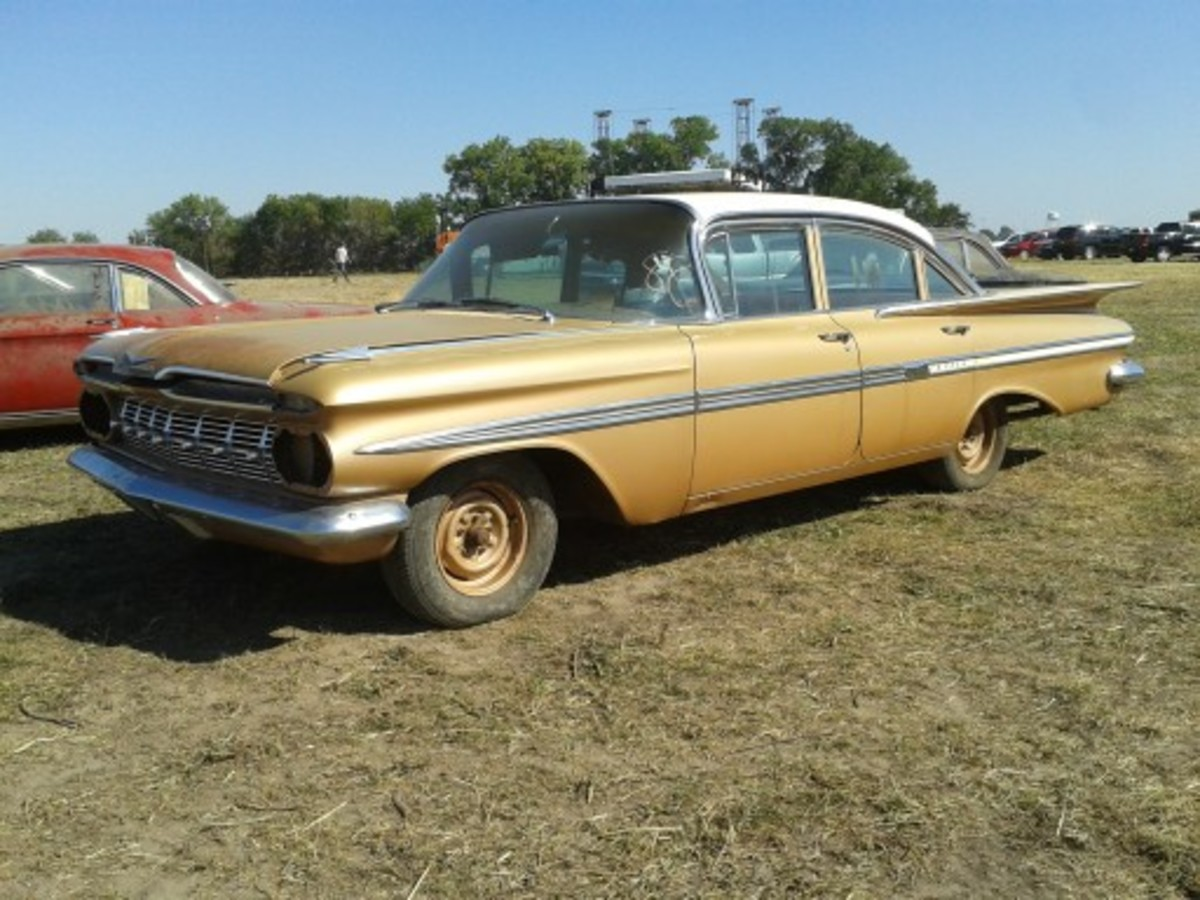 The second highest-selling example among five unsold 1959 Chevrolet four-doors was this Impala sedan. Its missing headlamps and tail lamps were included in the $14,500 selling price. The odometer showed 2.2 miles.