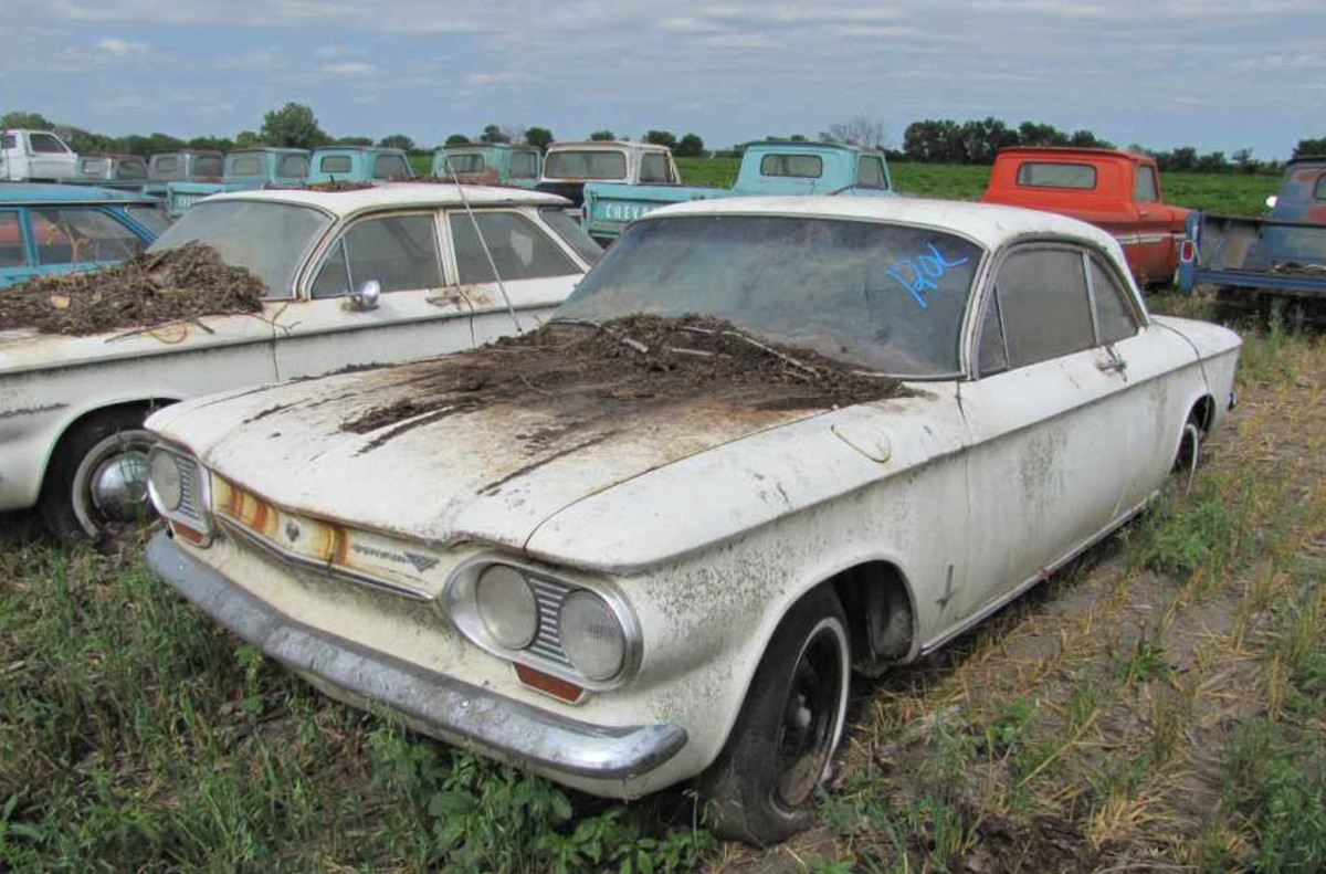 There are two 1963 Corvair Monza coupes in the Lambrecht Collection, to be offered by VanDerBrink. One was stored inside, this one has been in the weather. This one should sell for a song compared to the indoor-stored car. Although it will sell for more, go for the indoor-stored example - it will be cheaper in the long run.