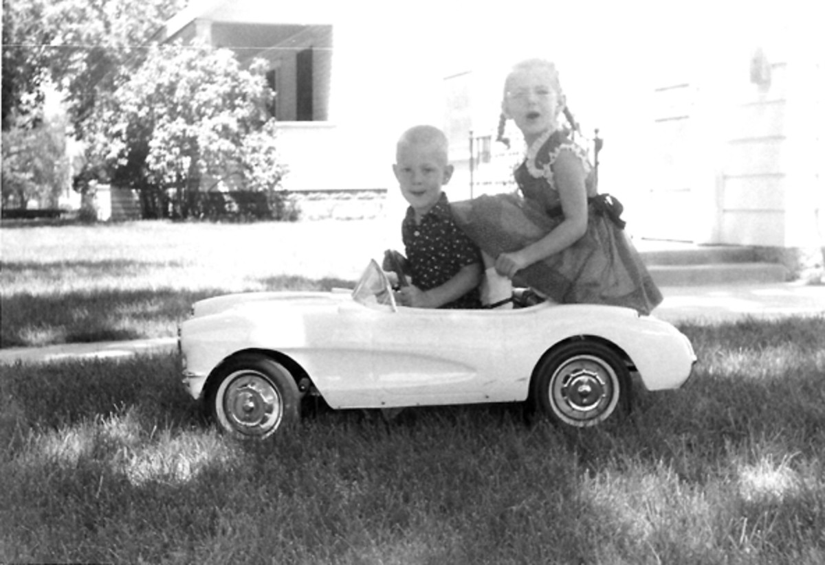 Mark and Jeannie Lambrecht in a pedal car (also pictured below) that is part of the collection.