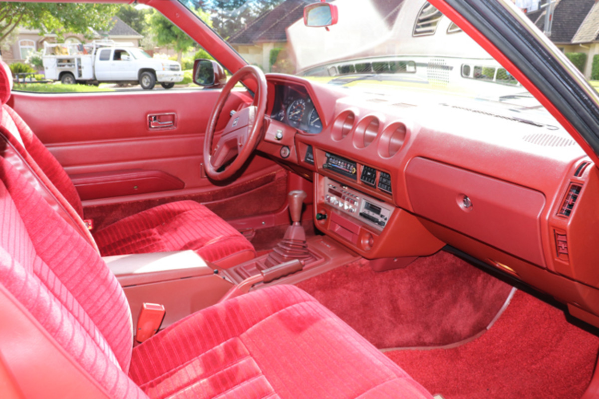 "Velour abounds in the Japanese techno-lux interior. The feature car has a manual ""fun box"" transmission, but an automatic was also available."
