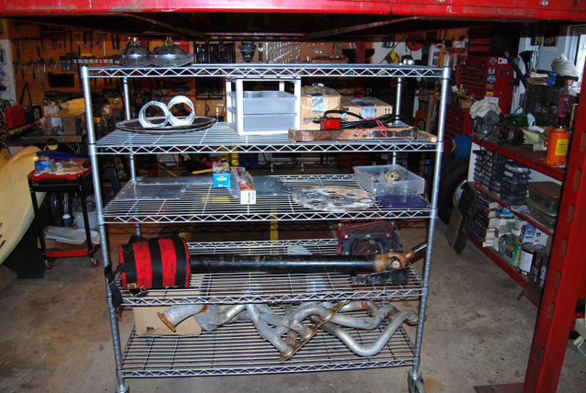 Sturdy wire shelves that roll on wheels, like this one, hold many parts.