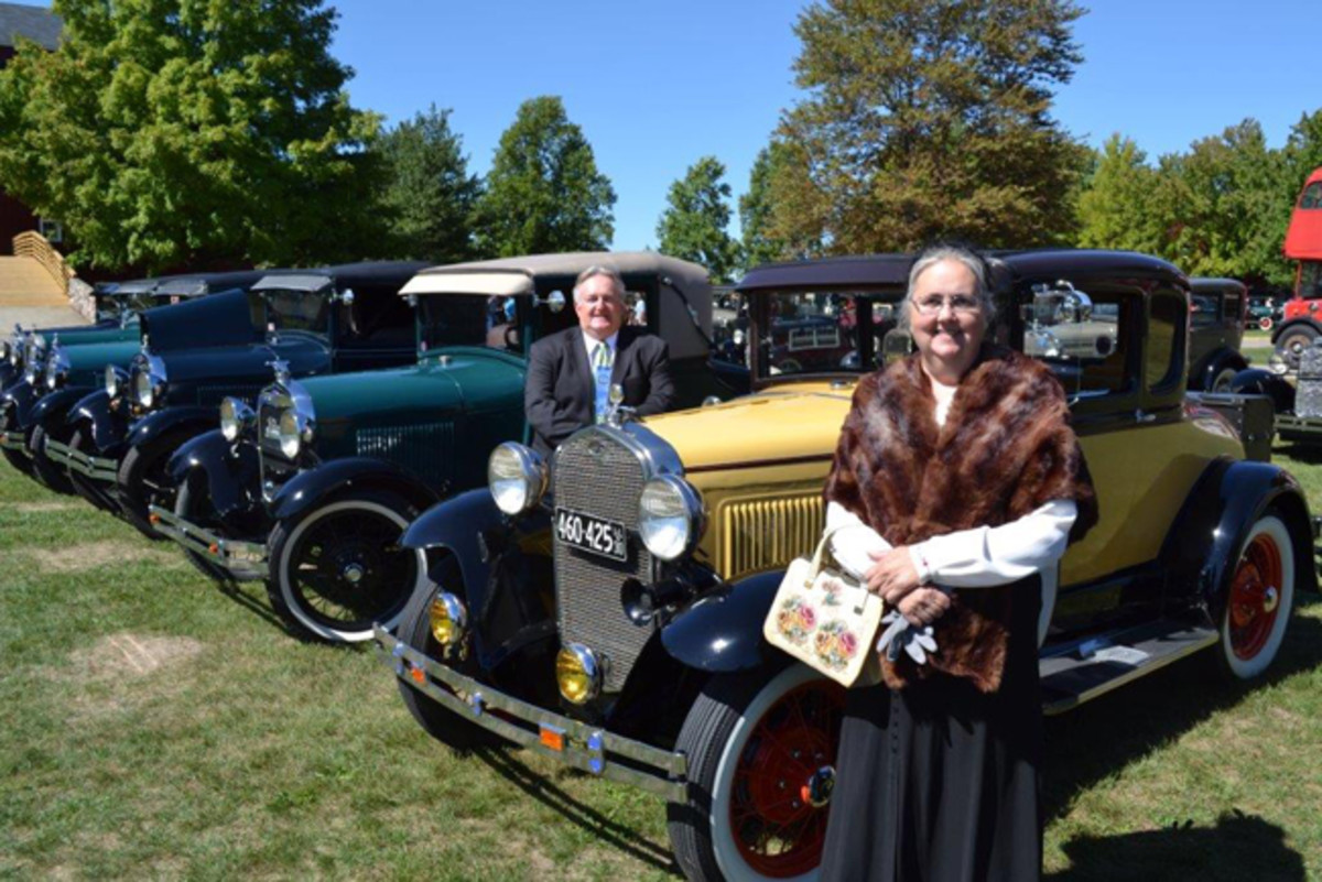 Dolores and Rev. Gary Dougherty of Alto, MI dressed in period correct attire as they are among a large group of Model A Fords which were produced from 1928 – 1931. Photo Gilmore Car Museum