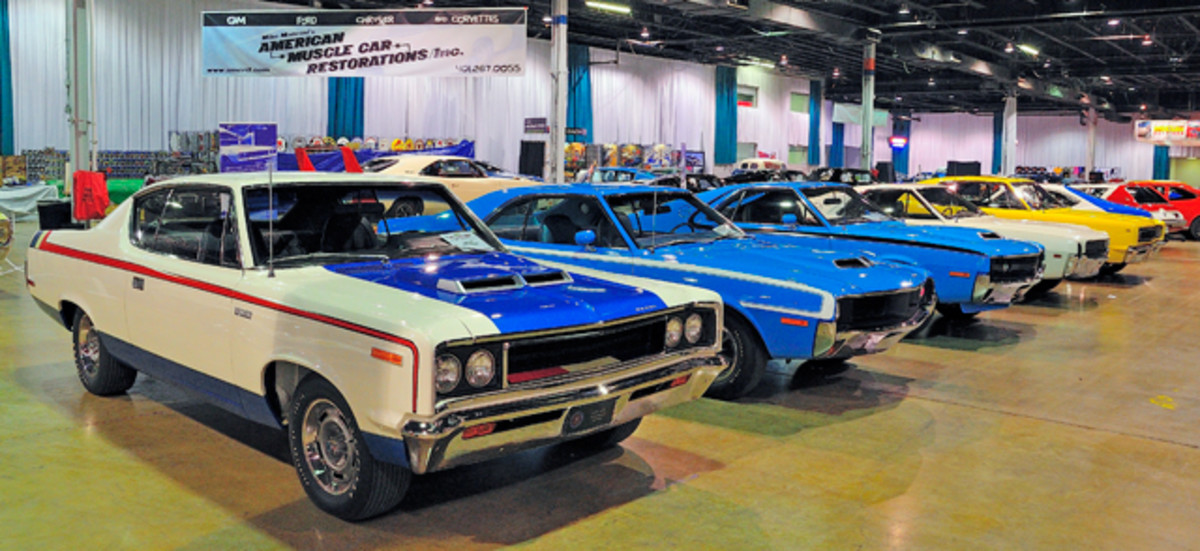 A display of AMC muscle cars.