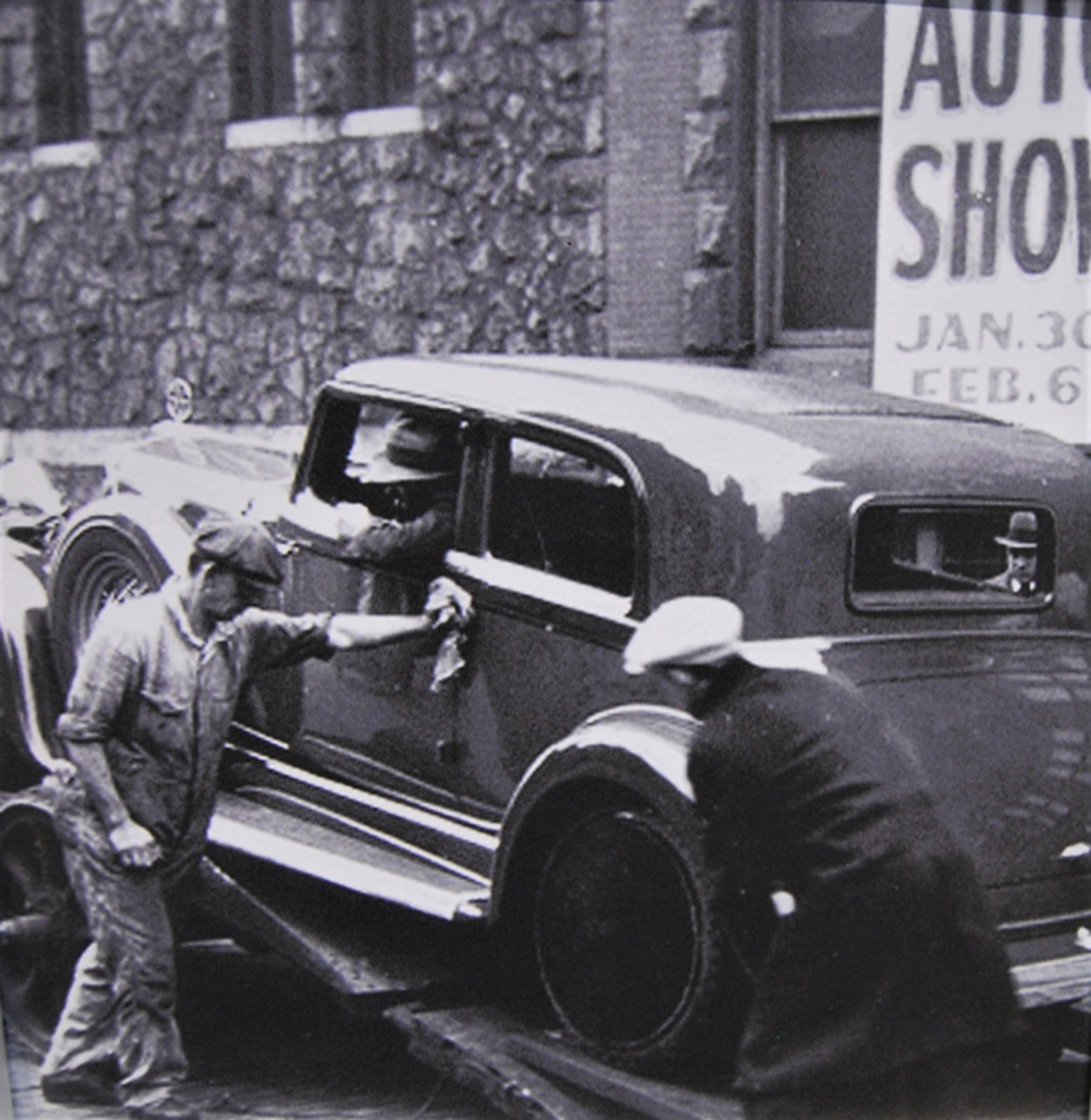 Workers delivering a car to the Chicago Auto Show in the 1930s.