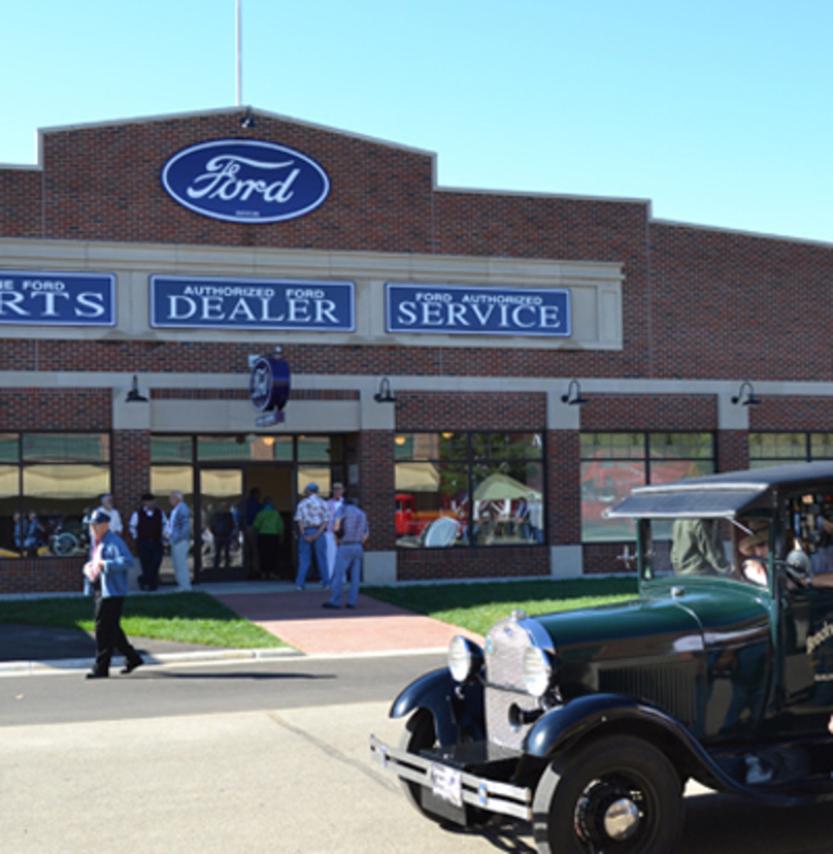 A Model A Ford pulls up in front of just one of the authentically re-created auto dealerships at the Gilmore Car Museum. Ford Motor Company introduced Model A in 1928 after producing more than 15 million Model Ts that were produced with little change between 1908 – 1927 - Photo Gilmore Car Museum