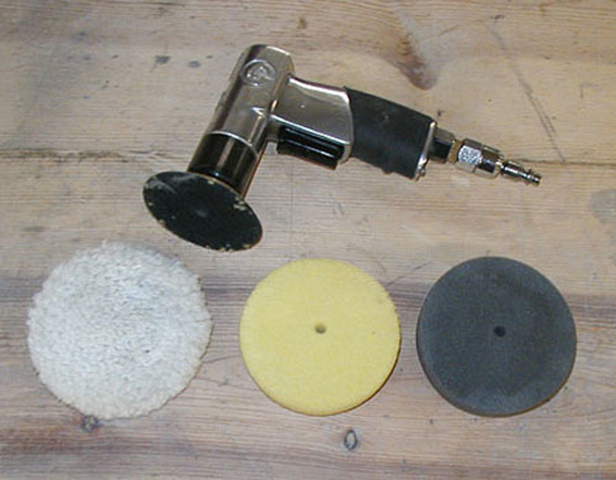 Three-inch polishing machine and pads. The wool pad (left) is rougher and is only used where spots require more aggressive treatment.