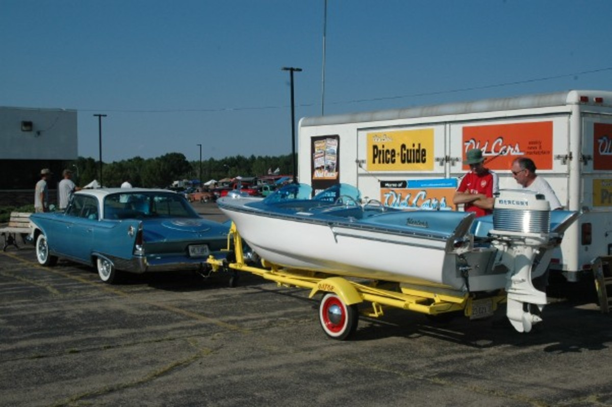 Trevor and Marla Yoho brought two sets of fins — two for land, two for water — to the Theme exhibit. The land-locked fins are on a 1960 Plymouth Fury four-door hardtop, while the water-bourne fins adorn a 1959 Herters Flying Fish boat.