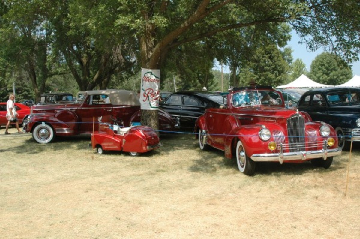The Wisconsin Packard Club's display was braced by this duo of 1941 convertible coupes: a One-Twenty and a One-Sixty. Also note the mini 1941 One-Sixty, which was molded by hand from fiberglass on a 1972 Montgomery Ward lawn mower by the One-Sixty's previous owner.