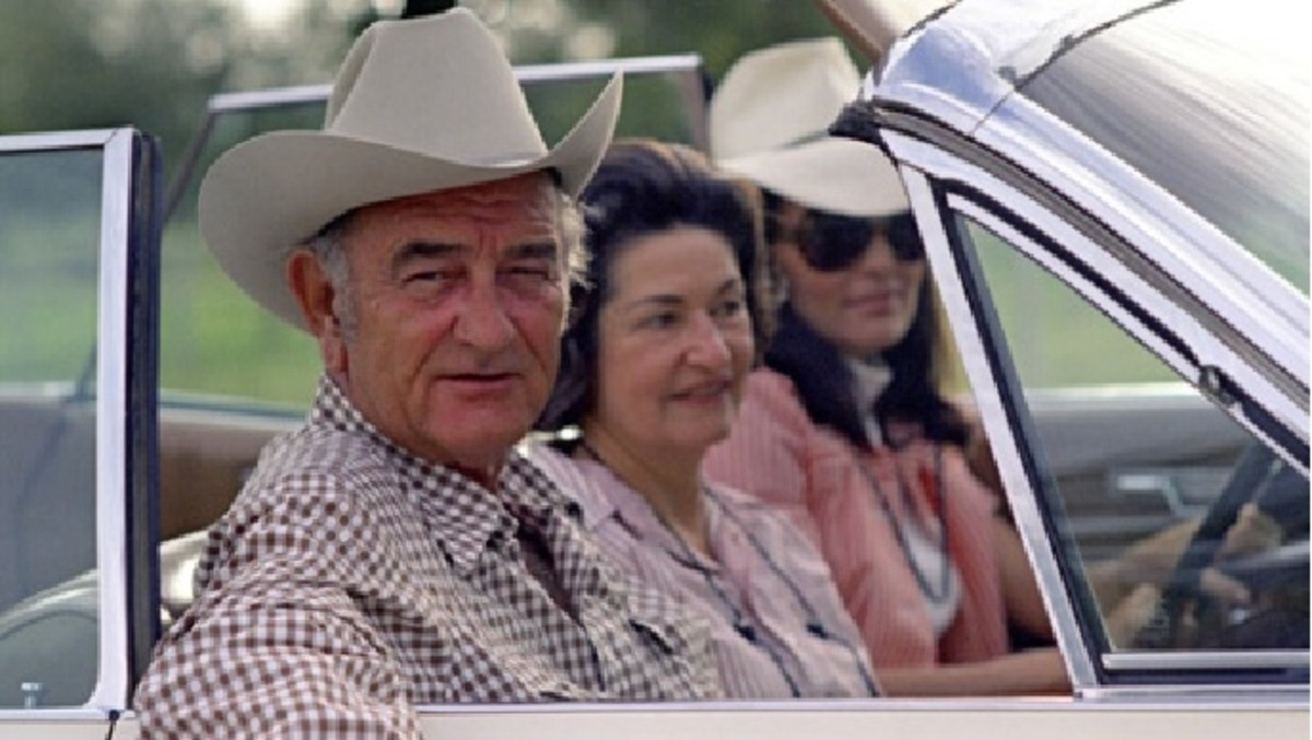 President Johnson pictured in his 1964 Lincoln Continental convertible, which he frequently drove around his Texas ranch.