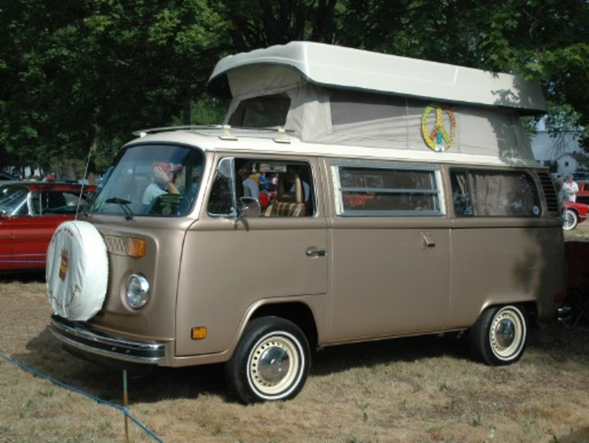 Speaking of buses, John Benz brought two Volkswagens —a Karmann Ghia and this 1977 Type 2 camper bus. Both are attractive brown colors.