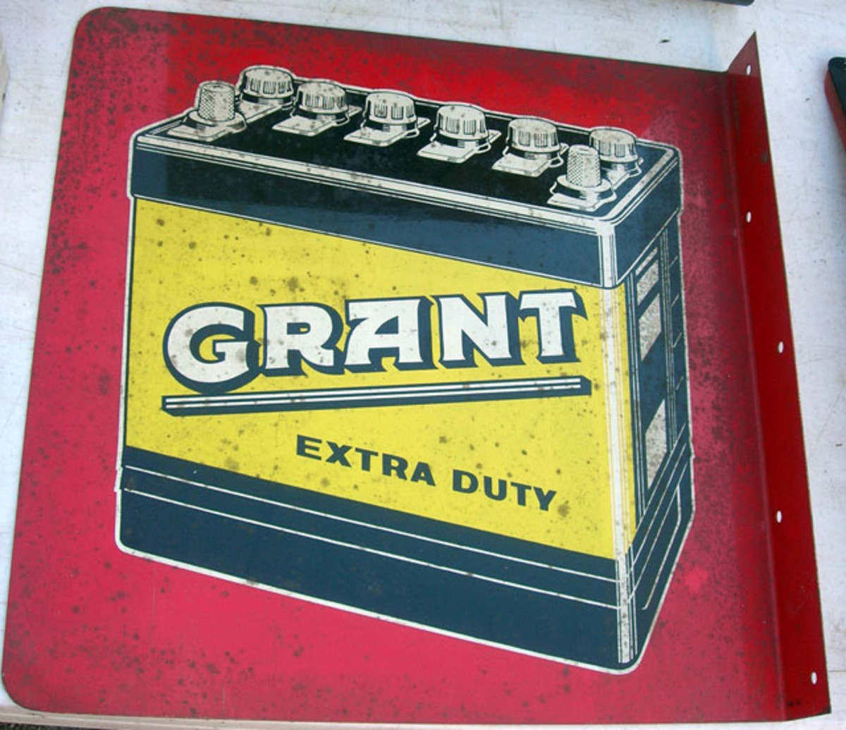 Flanged, metal, two-sided Grant battery sign sold for $80.
