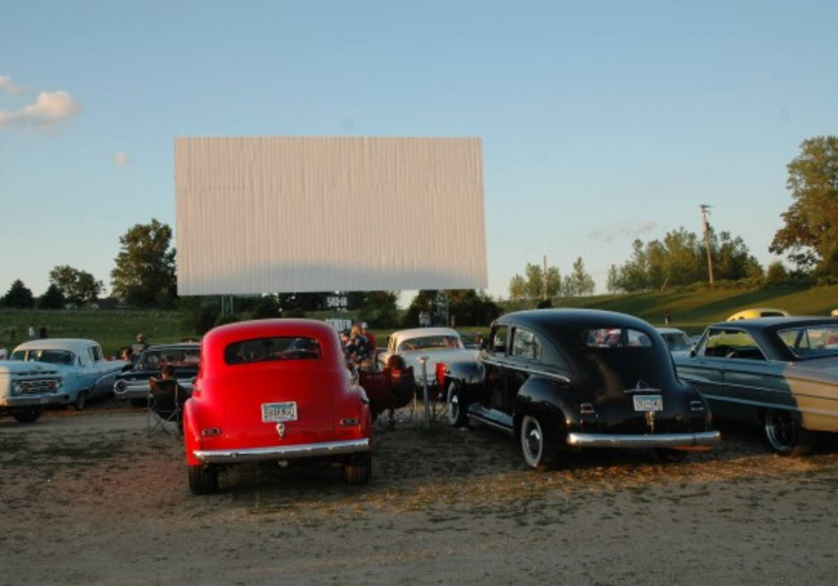Hot rods, customs and stockers begin parking in front of the Cottage View Drive-In's screen before sundown.